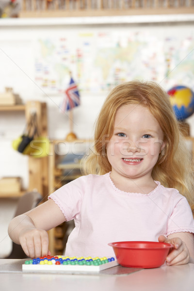 Young Girl Playing at Montessori/Pre-School Stock photo © monkey_business