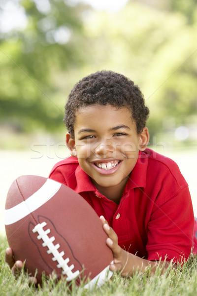 ストックフォト: 少年 · 公園 · アメリカン · サッカー · 草 · 幸せ
