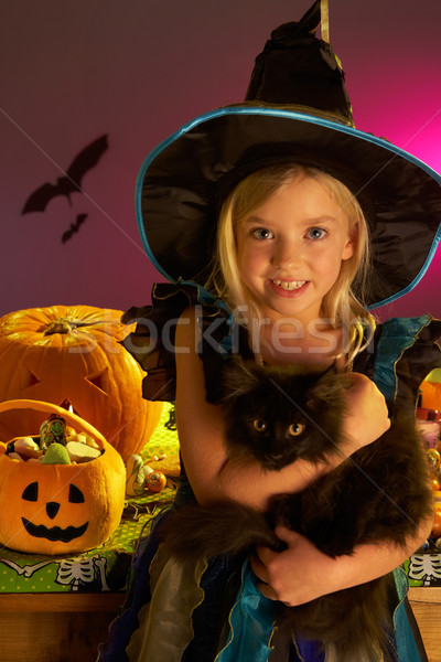 Halloween party with a child holding black cat in hand Stock photo © monkey_business