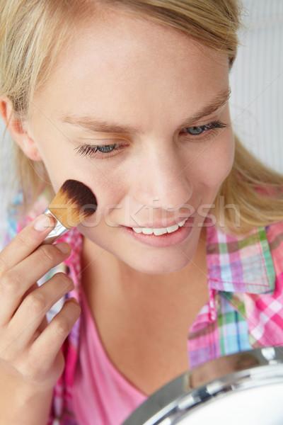Teenage girl putting on make-up Stock photo © monkey_business