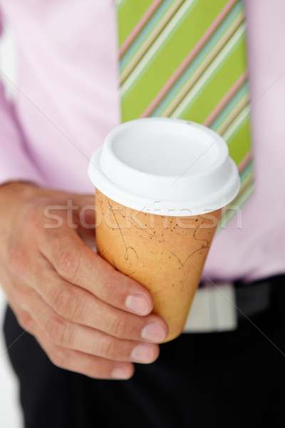 Businessman holding takeout coffee Stock photo © monkey_business