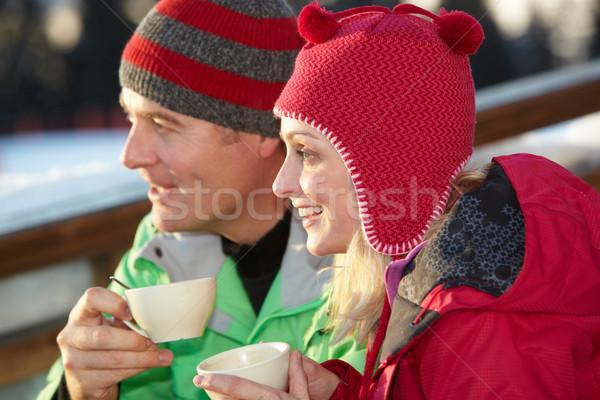 Paar genieten warme drank man gelukkig sneeuw Stockfoto © monkey_business