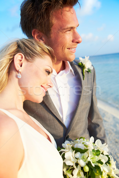 Bride And Groom Getting Married In Beach Ceremony Stock photo © monkey_business