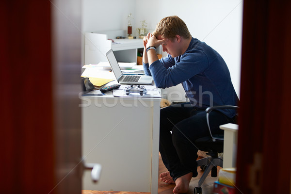 Teenage Boy Studying In Bedroom Using Laptop Stock photo © monkey_business