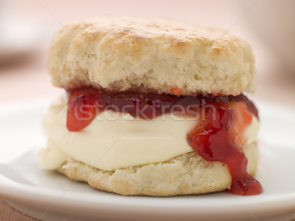 Scone Filled with Strawberry Jam and Clotted Cream on a plate Stock photo © monkey_business