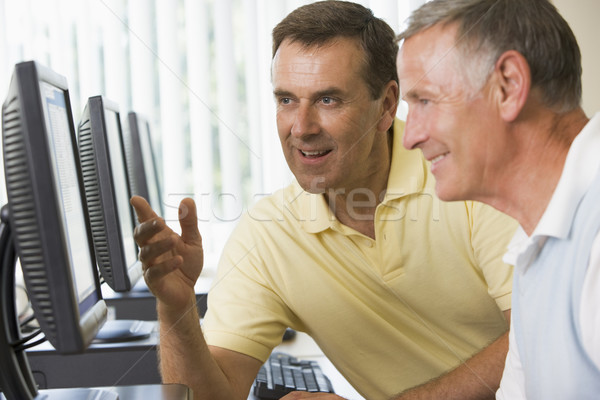 Stock photo: Adult students working on computers together