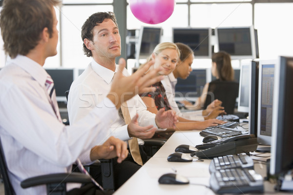 Five businesspeople in office space with a ball being thrown Stock photo © monkey_business