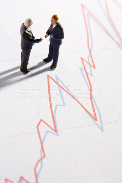 Kettő üzletemberek kézfogás vonal grafikon pénzügy Stock fotó © monkey_business