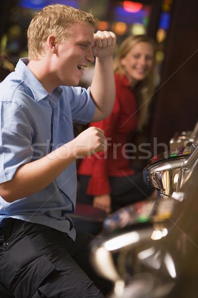 Férfi ünnepel győzelem játékautomata kaszinó boldog Stock fotó © monkey_business