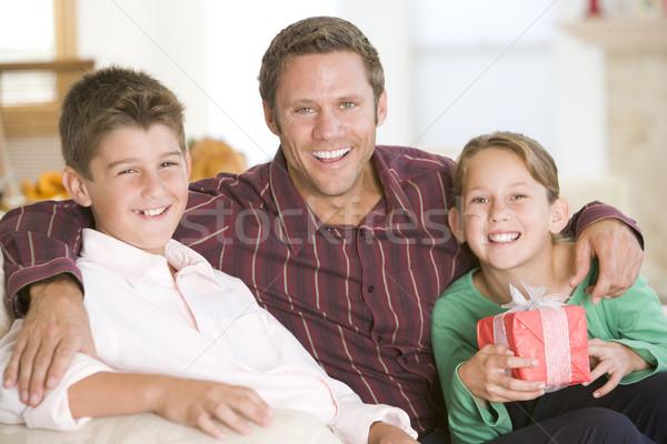 Семейный портрет Рождества девушки человека ребенка гостиной Сток-фото © monkey_business