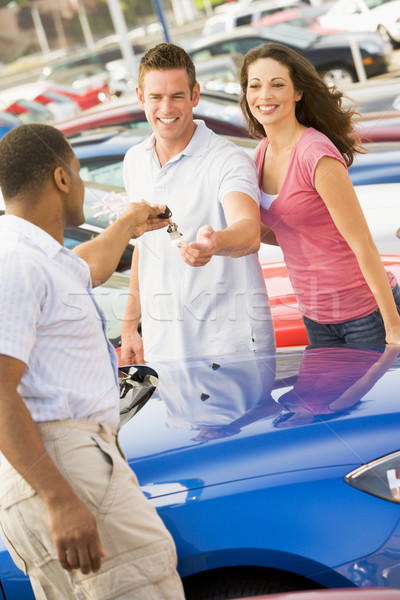 Young couple collecting new car Stock photo © monkey_business