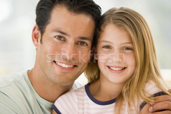 Uomo giovane ragazza soggiorno sorridere ragazza sorriso Foto d'archivio © monkey_business