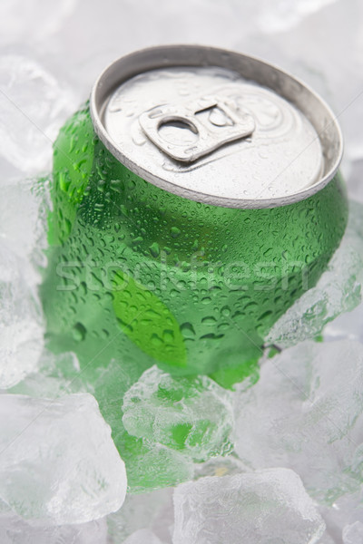 Green Can Of Fizzy Soft Drink Set In Ice  Stock photo © monkey_business
