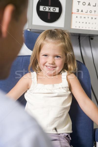 Optometrikus vizsga szoba fiatal lány szék mosolyog Stock fotó © monkey_business