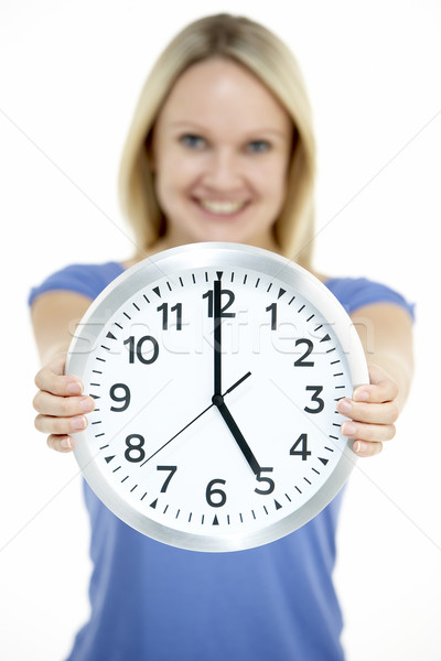Woman Holding Clock Showing 5 O'Clock Stock photo © monkey_business