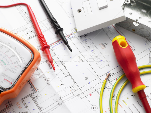 Stock photo: Electrical Equipment On House Plans