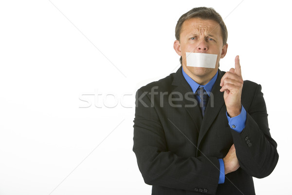 Stock photo: Businessman With His Mouth Taped Shut And Pointing