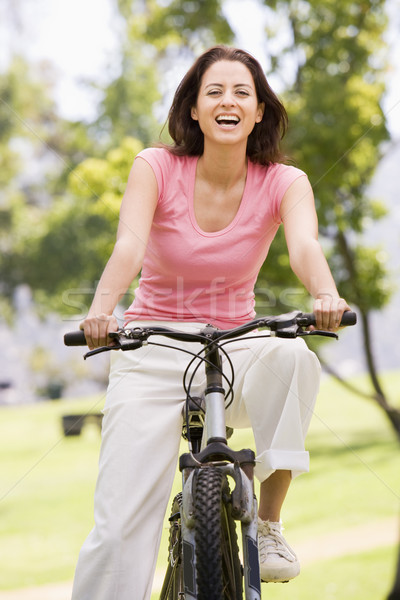 Woman on bicycle smiling Stock photo © monkey_business