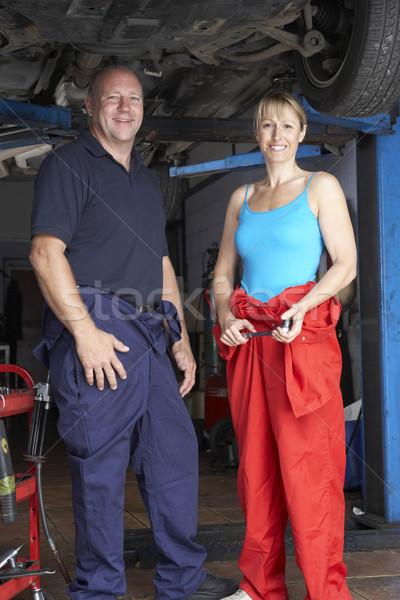 Male and female mechanics working on car Stock photo © monkey_business