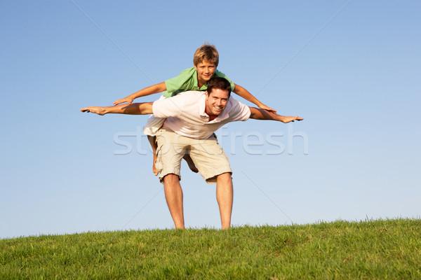 Stock fotó: Fiatalember · fiú · játszik · mező · égbolt · tavasz
