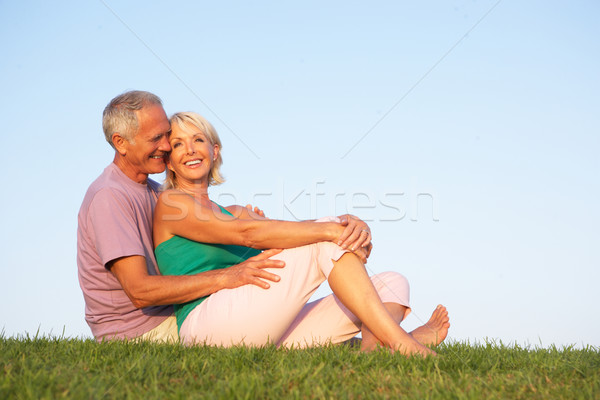 Senior couple posing on a field Stock photo © monkey_business