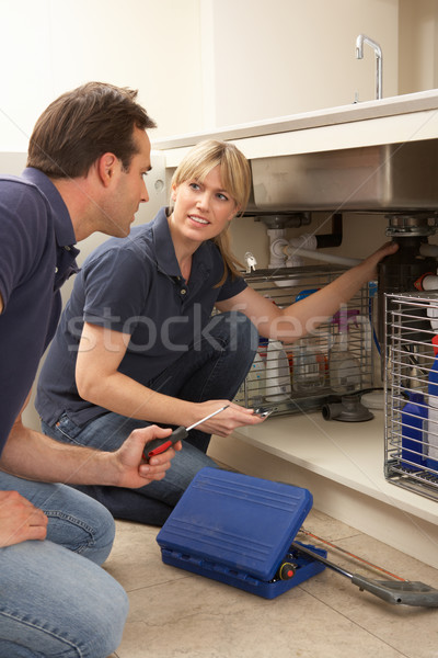 Plumber Teaching Apprentice To Fix Kitchen Sink In Home Stock photo © monkey_business