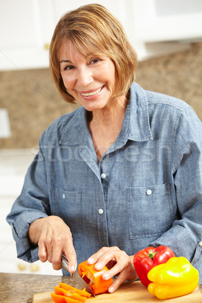 Mid age woman chopping vegetables Stock photo © monkey_business