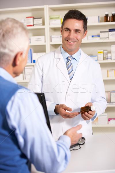 American pharmacist with senior man in pharmacy Stock photo © monkey_business