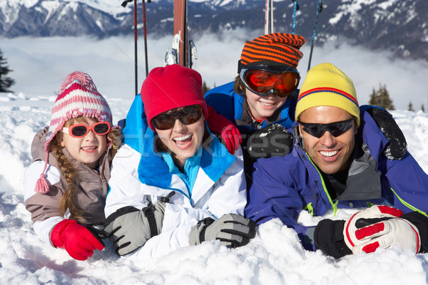 Family Having Fun On Ski Holiday In Mountains Stock photo © monkey_business