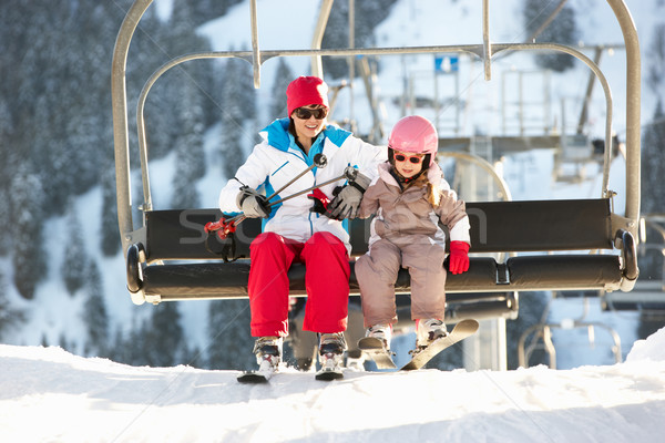 Mother And Daughter Getting Off chair Lift On Ski Holiday In Mou Stock photo © monkey_business