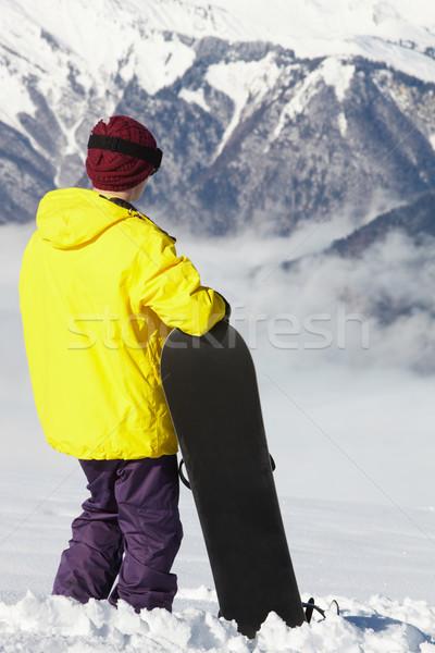 Teenage Snowboarder Admiring Mountain View Whilst On Ski Holiday Stock photo © monkey_business