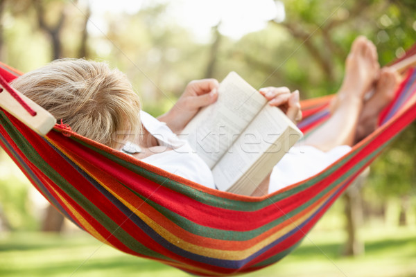 Senior Woman Relaxing In Hammock With Book Stock photo © monkey_business