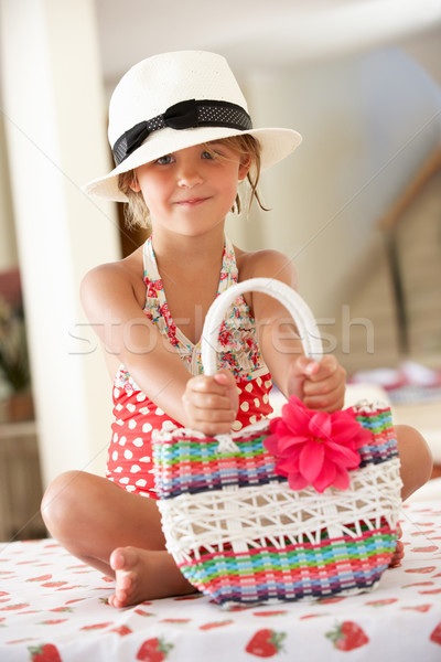 Fille maillot de bain chapeau de paille sac jardin Photo stock © monkey_business