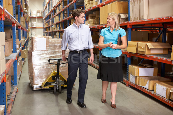 Businesswoman And Colleague In Distribution Warehouse Stock photo © monkey_business