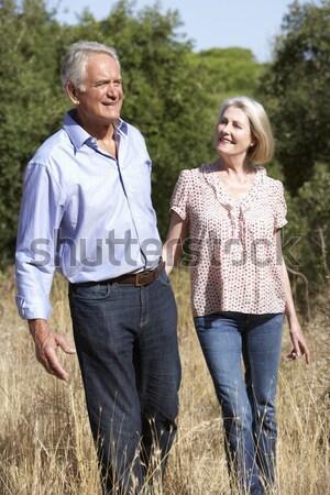 Senior Couple On Country Walk Through Woodland Stock photo © monkey_business