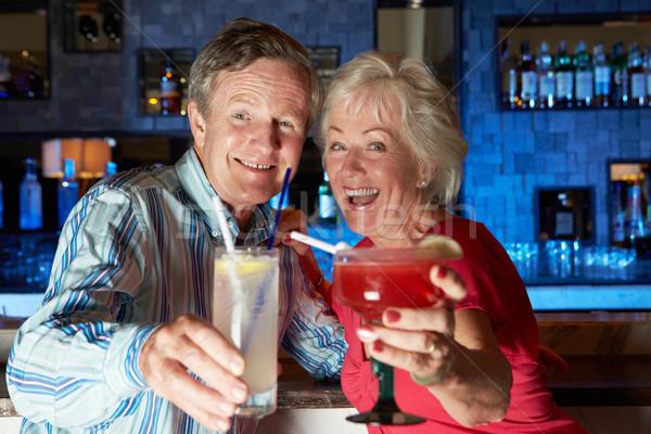 Senior Couple Enjoying Cocktail In Bar Stock photo © monkey_business