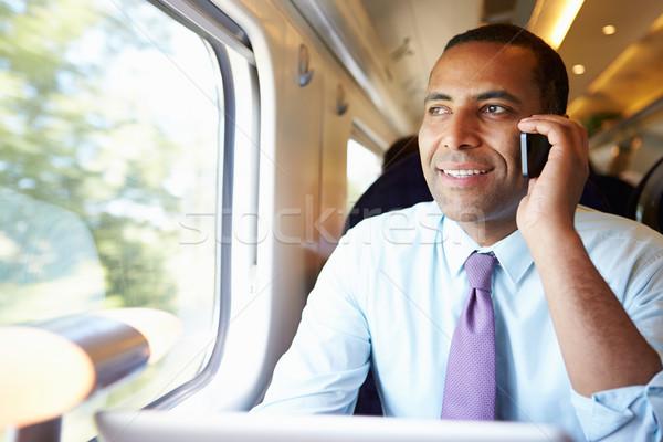 Empresário pendulares trabalhar trem telefone móvel homem Foto stock © monkey_business