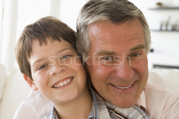Grandfather and grandson indoors smiling Stock photo © monkey_business