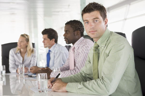 Four businesspeople in a boardroom Stock photo © monkey_business