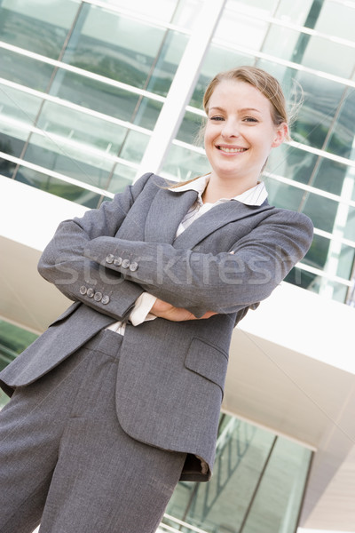 Businesswoman standing outdoors smiling Stock photo © monkey_business