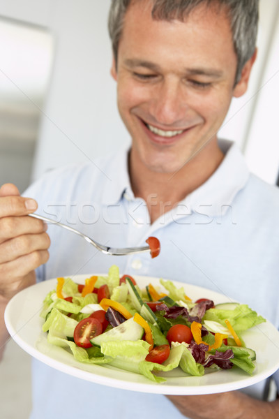 Középkorú férfi egészségesen enni saláta férfi boldog tányér Stock fotó © monkey_business