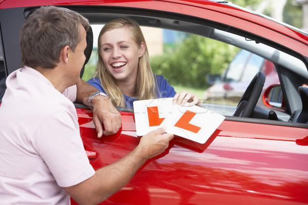 Teenage Girl Receiving Her Learner Plates Stock photo © monkey_business
