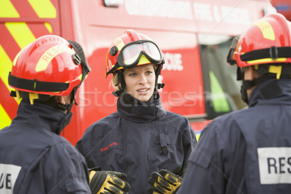 Stock photo: A firefighter giving instructions to her team