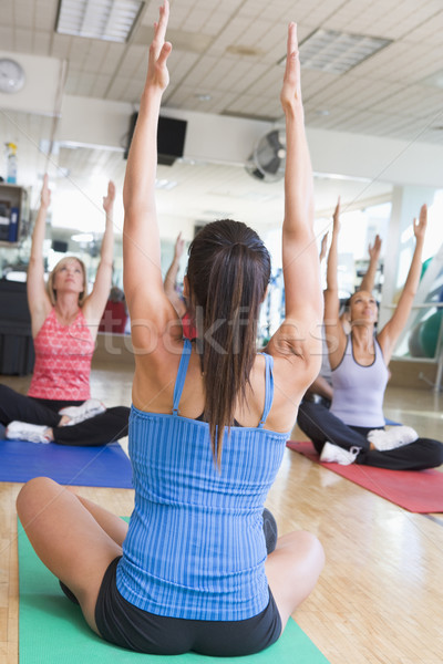 Instructor Taking Yoga Class At Gym Stock photo © monkey_business