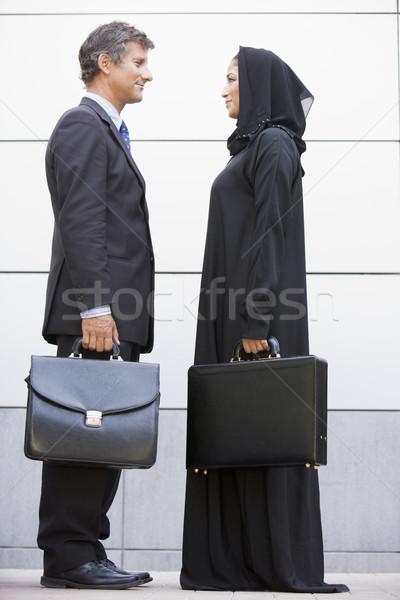 Сток-фото: кавказский · бизнесмен · женщину · рукопожатием · портфель