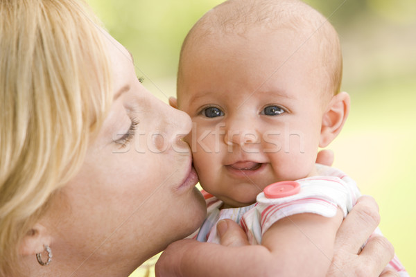 Mother kissing baby outdoors Stock photo © monkey_business