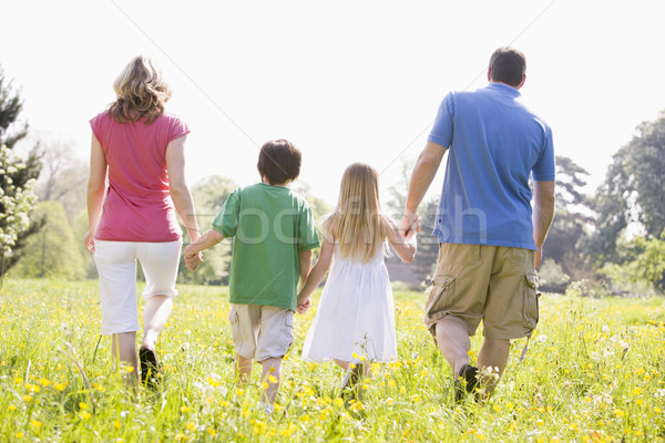 Stock photo: Family walking outdoors holding hands