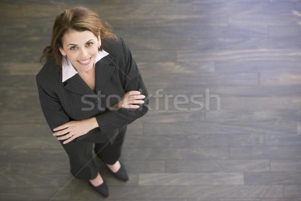 Empresária em pé sorridente mulher trabalhar Foto stock © monkey_business