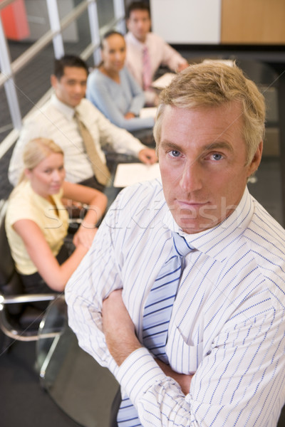 Businessman with four businesspeople at boardroom table in backg Stock photo © monkey_business