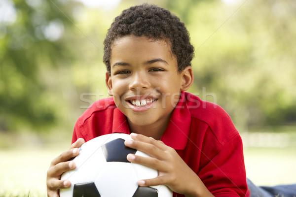Stockfoto: Jongen · park · voetbal · gras · voetbal · gelukkig